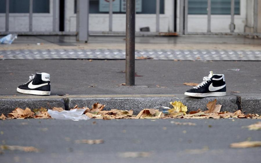 A pair of abandoned shoes seen left in the street near the Bataclan concert hall the morning after a series of deadly attacks in Paris, November 14, 2015. REUTERS/Charles Platiau TPX IMAGES OF THE DAY TPX IMAGES OF THE DAY