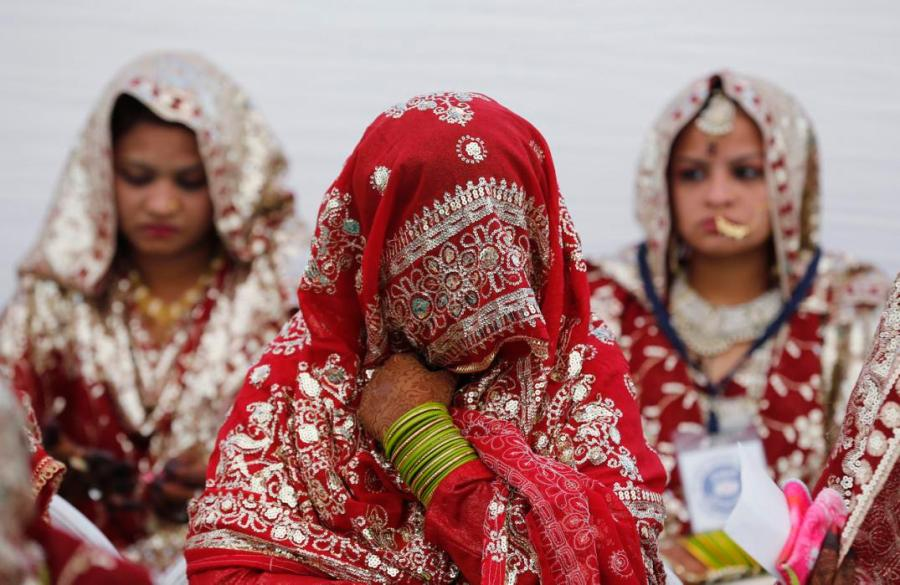 Muslim brides wait for the start of a mass marriage ceremony in Ahmedabad, India, February 7, 2016. A total of 84 Muslim couples from various parts of Ahmedabad on Sunday took wedding vows during the mass marriage ceremony organised by a Muslim voluntary organisation, organisers said. REUTERS/Amit Dave TPX IMAGES OF THE DAY