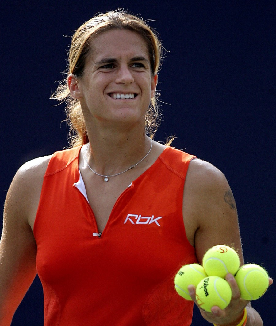 World's number one Amelie Mauresmo prepares to hit her autograph ball to the crowd after beating China's Sun Tiantian in the second round match of the China Open tennis tournament in Beijing 21 September 2006. Mauresmo makes her Chinese tennis debut as top seed at the China Open in an event featuring four top ten players, after her lone appearances in Asia came in 1999 and 2000 when she played in Tokyo. Mauresmo won 6-3, 6-2. AFP PHOTO/GOH CHAI HIN